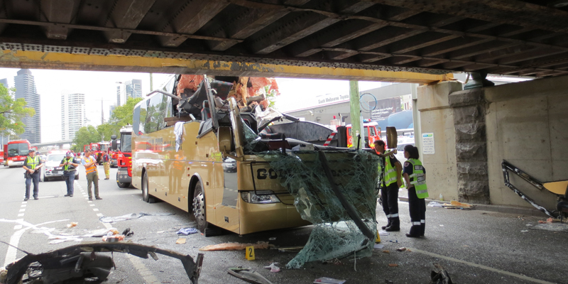 Bus hits bridge