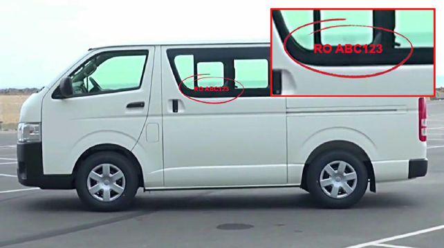 Minibus with ID number sticker on window