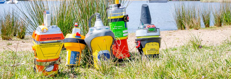 EPIRBs lined up on grass