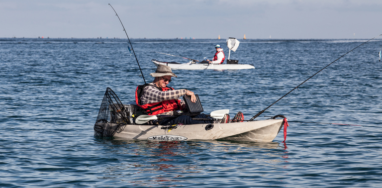 Photo of a man kayak fishing