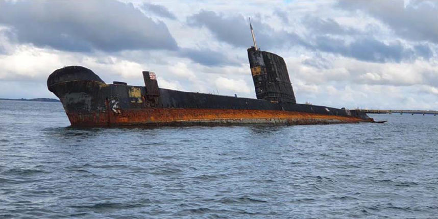 Submarine listing in the water