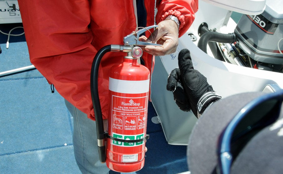 Boater holds fire extinguisher