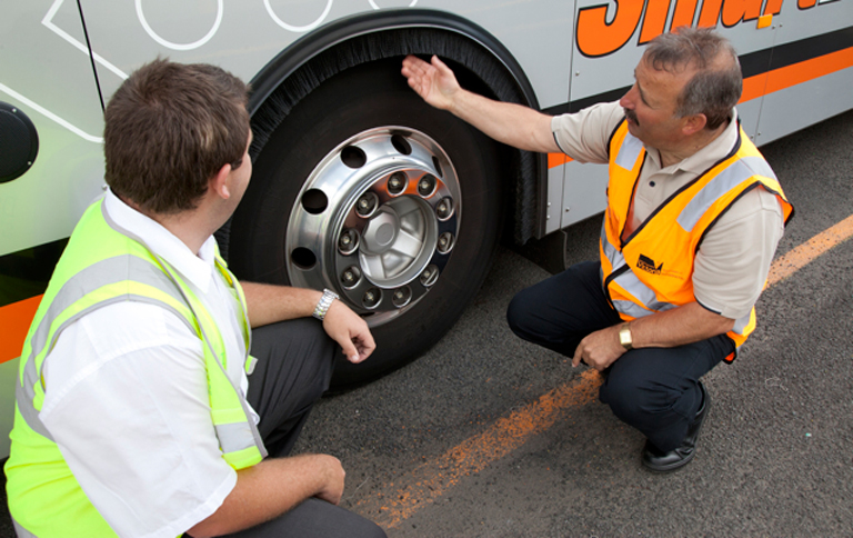 BSCO inspecting a bus wheel