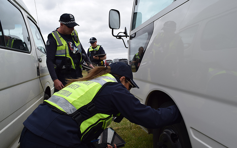 BSV and police inspect a bus wheel