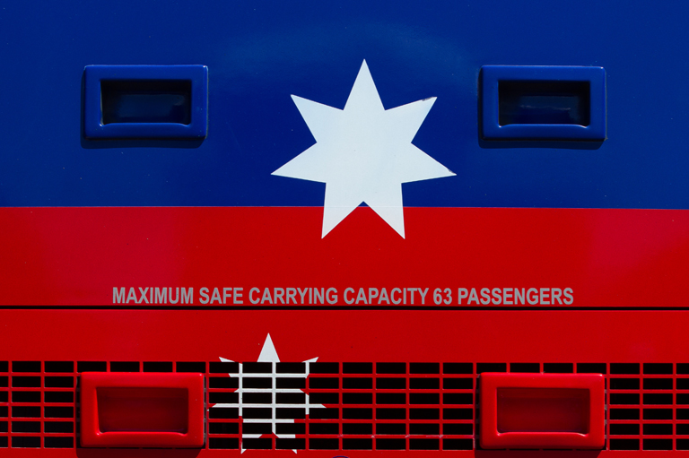 Maximum safe carrying capacity sticker on a bus