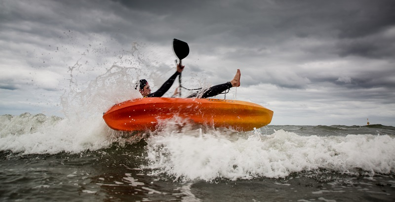 A kayaker capsizing
