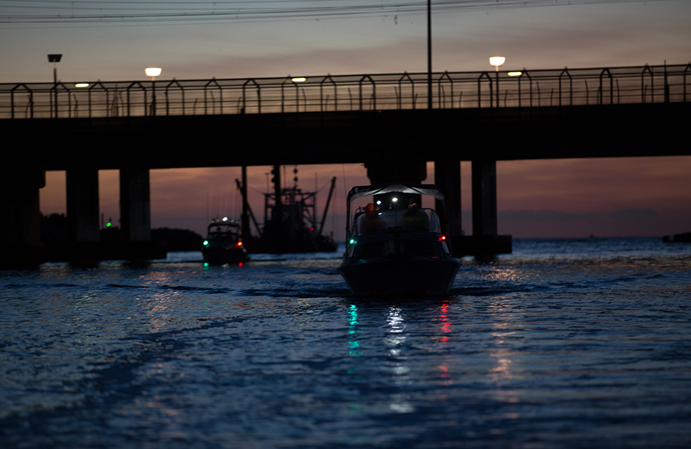 Boats with lights at dusk
